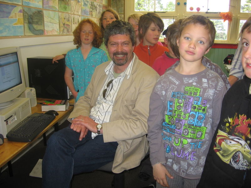 Dr Wayne Mackintosh with children at Warrington School on signing the Cape Town Open Education Declaration